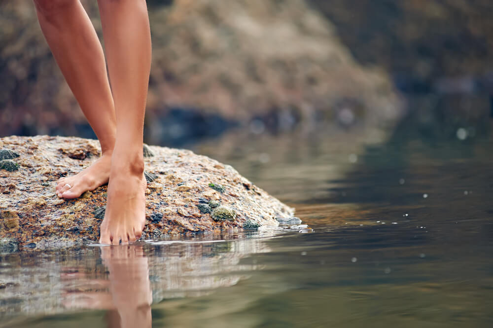 woman dipping her toe in the water